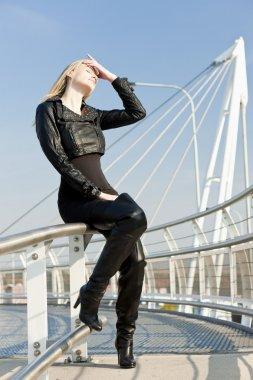 Woman wearing fashionable black boots