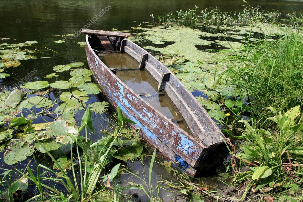 Old wooden boat in water — Stock Photo © pklimenko #2952605
