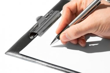Pen in a hand ready for writing on a paper in clipboard stock vector