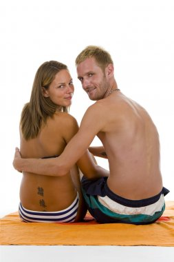 Couple on a beach towel