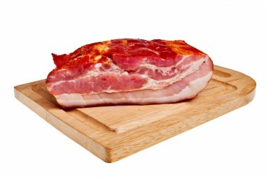 Smoked bacon on wooden board.