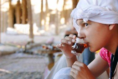 Girl drinking orient tea