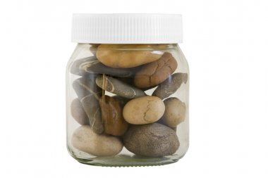 Transparent jar with different stones