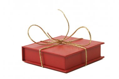 Red present box with golden shiny ribbon