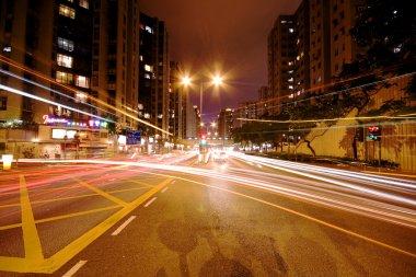 Modern Urban City with Freeway Traffic at Night