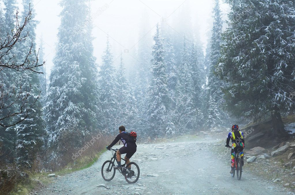 Two bikers in spring mountains