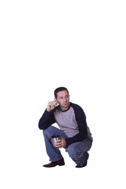 Crouched Mediterranean Man Smoking
