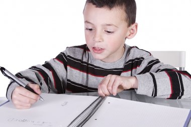 Little Cute Boy Practicing His Writing