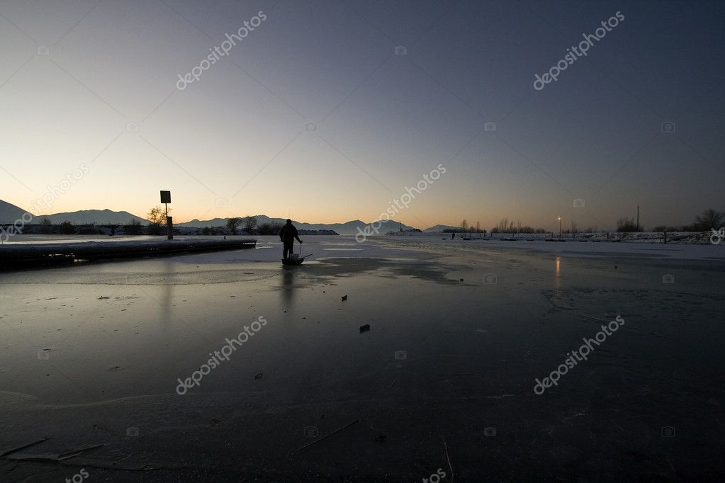 Fisherman Pulling his Sled on Ice