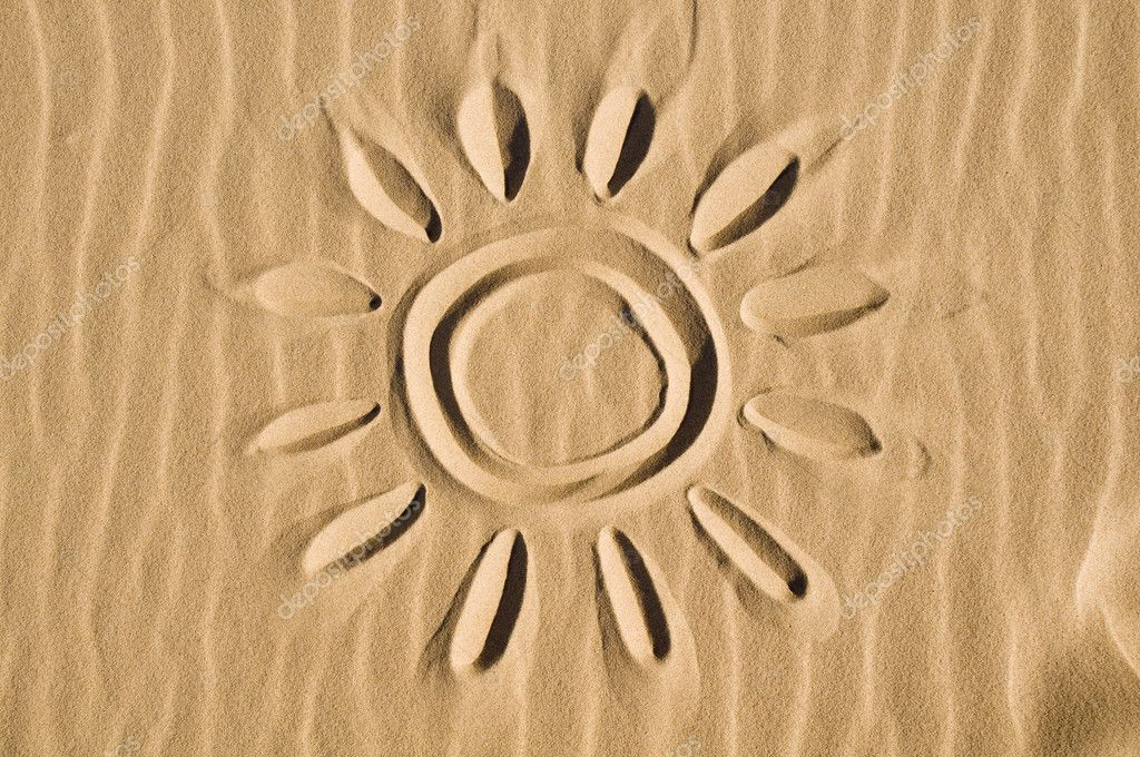 Sun drawn in the sand - closeup view