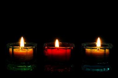 3 Lit Candles bottom border on black.