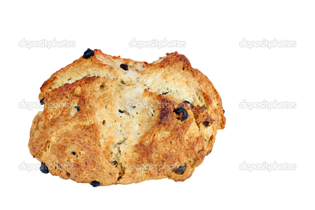 One freshly baked loaf of Irish Soda Bread on a white background with copy space.