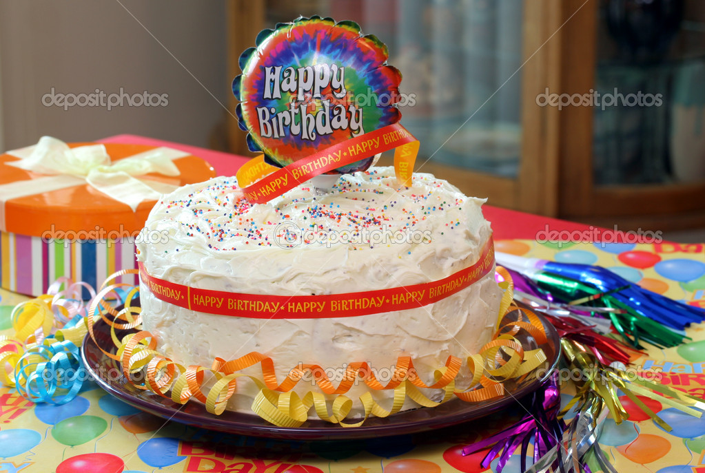 Beautiful Frosted Birthday Cake With Balloon Ribbons Gift And Party Horns
