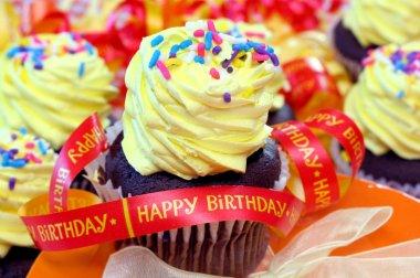 Birthday cupcake and ribbons