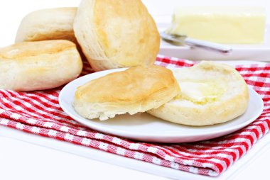 Dinner biscuits with melting butter.
