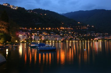 Switzerland, Montreux, a night view of Lake Geneva and the Alps