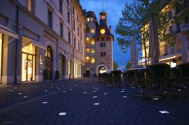 Geneva, Switzerland, one of the city streets at night with glowing paving b