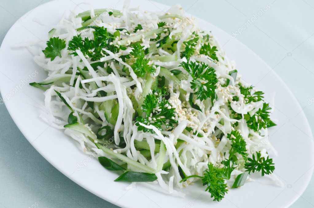 Salad of fresh cabbage and cucumber with herbs and sesame