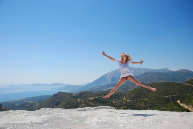 Girl on mountaion jumping