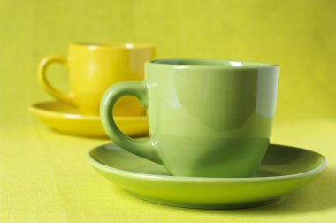 Yellow and green cups of coffee