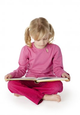 Six Year Old Girl Reading a Book