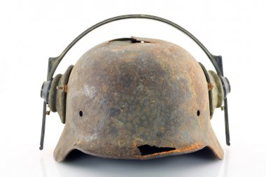 Rusty protective helmet with headphones