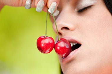 Beautiful women enjoying cherries