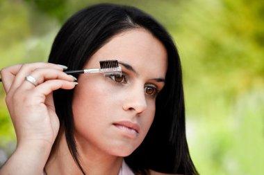 Beautiful women combing eye brows