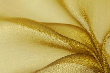 Golden organza fabric texture
