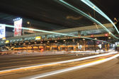 Fotografie Toll booths with car light in Hong Kong