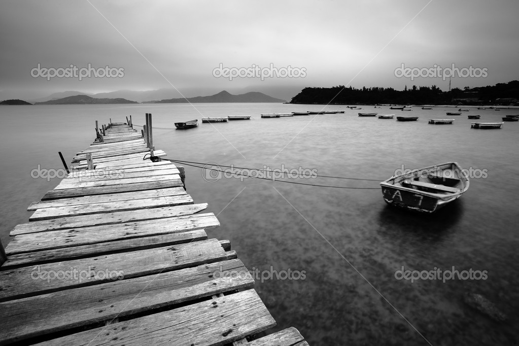 Wooden pier and boats