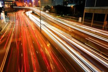 Blurs of night city traffic streams