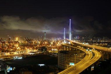 Container terminal and bridge in Hong Kong at night