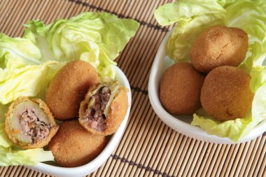 Fried olives in white bowls