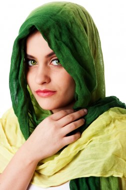Face with green eyes and scarf