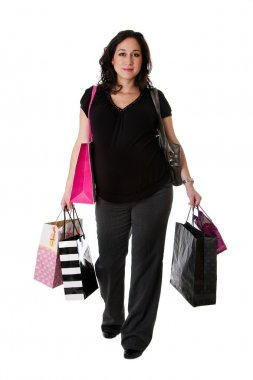 Pregnant woman with shopping bags