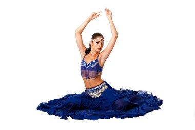 Belly dancer sitting on floor