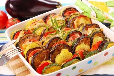 Vegetable casserole with aubergine,zucchini,tomato,potato and cheese stock vector