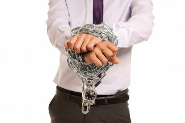 Businessman hands fettered with chain and padlock, job slave symbol, isolat