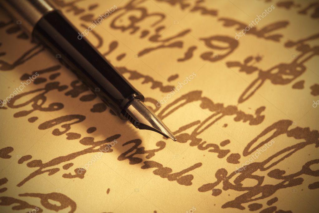 Pen on handwritten paper close-up