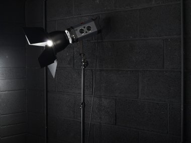 Photography studio light against a black