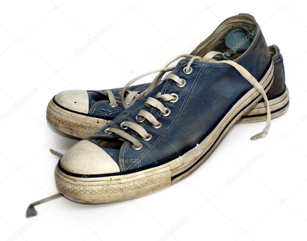 Old used and worn out sneakers