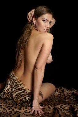 The bared girl in a leopard skin