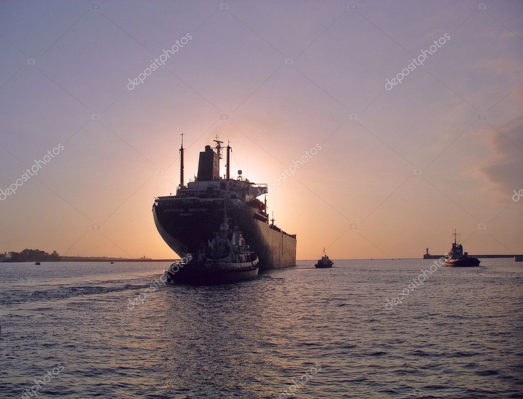 Ship leaving port for dusk or dawn