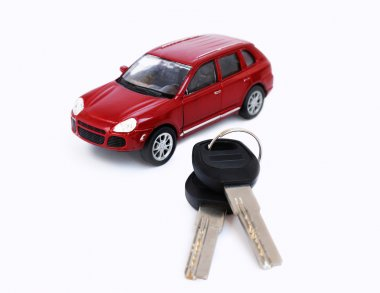 Red toy car model with keys