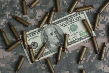 Money and shells on combat uniform stock vector