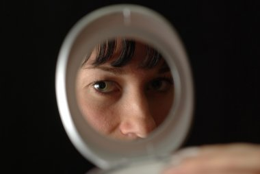 Female face reflected in mirror