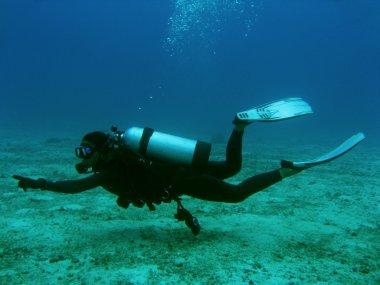 Dive master underwater female scuba diver boracay island philippines