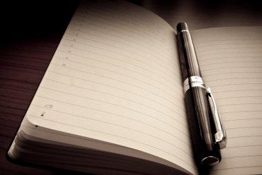 Pen on organizer / agenda