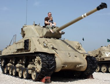 Father and son at the Museum of tanks